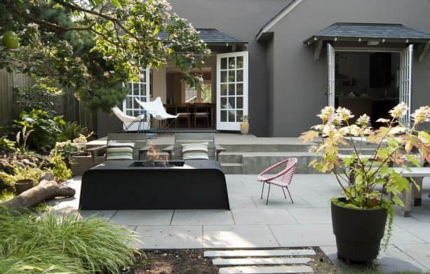 modern patio with concrete paver and black metal fire pit