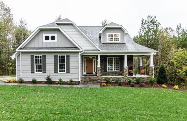simple but eye-catching white house gray shutters