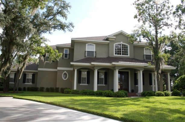 the use of taupe stucco and white trim for a classic neutral look in a traditional exterior