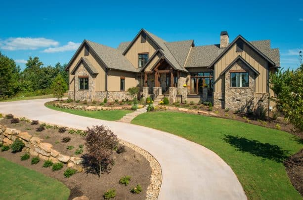 a rustic mountain home exterior with tan-painted siding