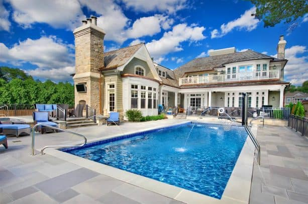 outdoor inground pool with spray water feature