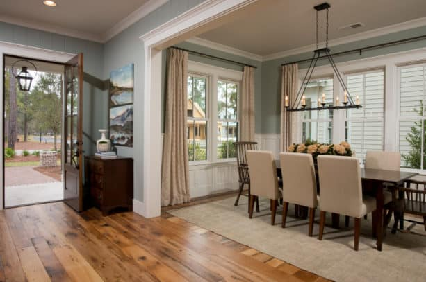 a timeless traditional entry and dining room with wood floor and white trim