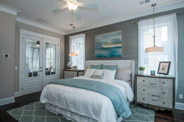 grey and white bedroom with blue accents