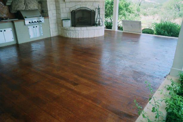 brown concrete wood floor in an open kitchen