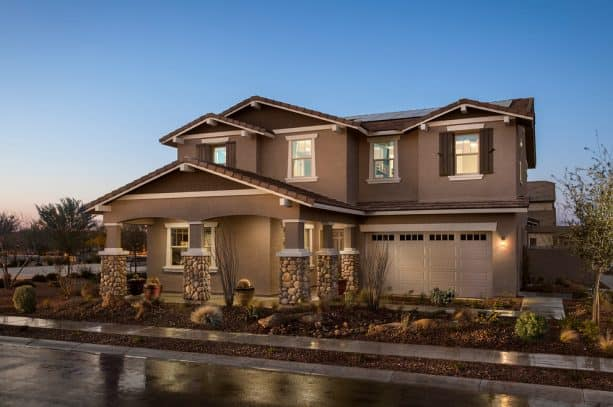 mediterranean exterior with brown stucco material and white trim