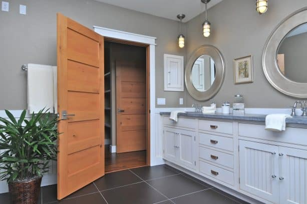 a wood door which frame is not painted in white as the trim