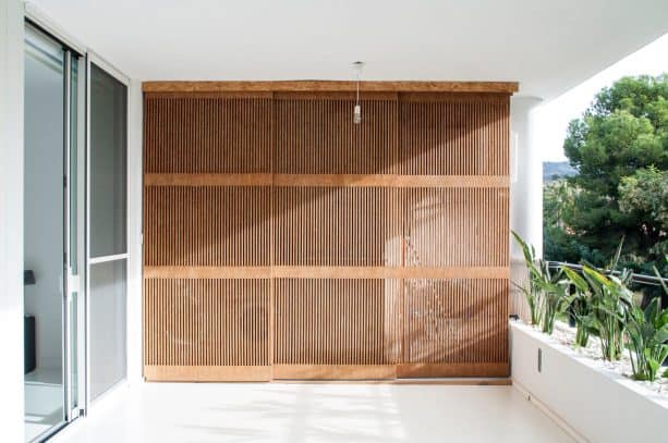 the closed laundry closet doors give a decorative value to the balcony design