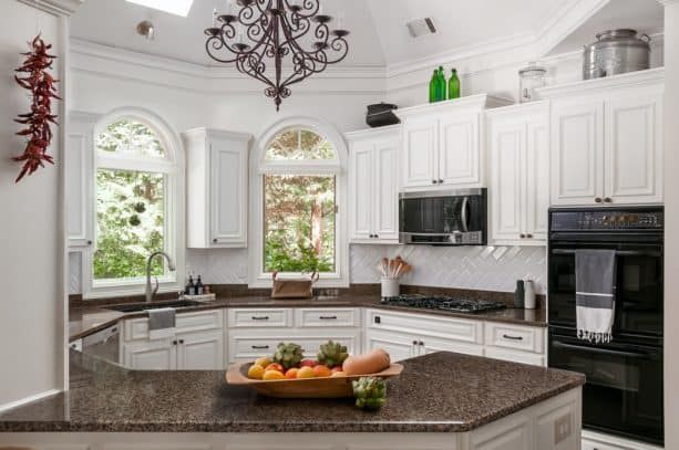 an octagon kitchen shape matched black stove and white raised-panel cabinets