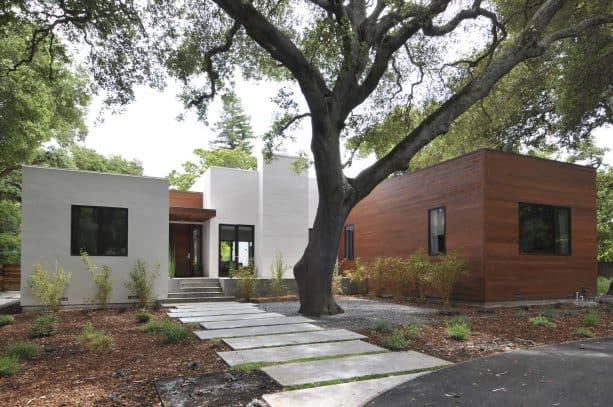 front walkway landscaping idea with contemporary-style concrete finish