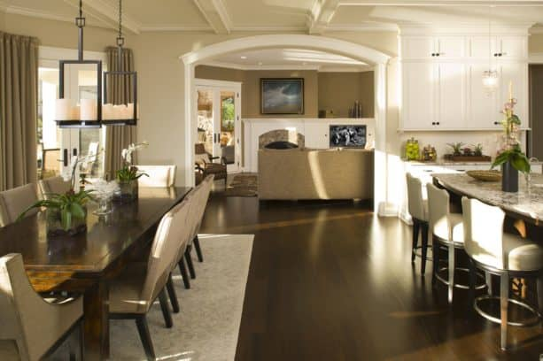 a traditional kitchen dining area with dark hardwood floor and white trim
