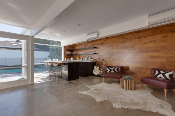 a mid-century modern family room with polished concrete floor