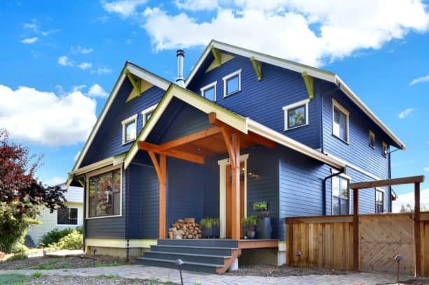 a navy blue craftsman house with white trim