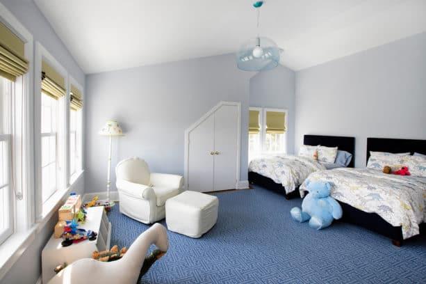 gender-neutral kids' bedroom with grey walls and patterned Aegean blue carpet flooring
