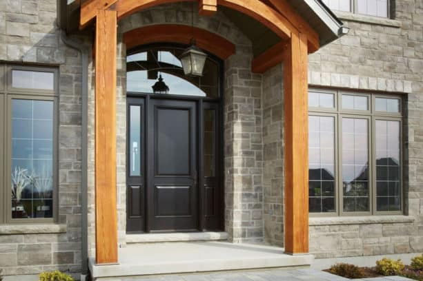 a custom black front door with sidelights and an oversized transom window