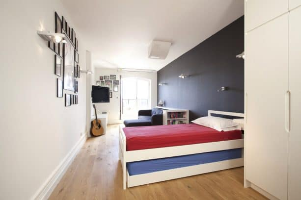 grey and red boys' bedroom with charcoal accent wall