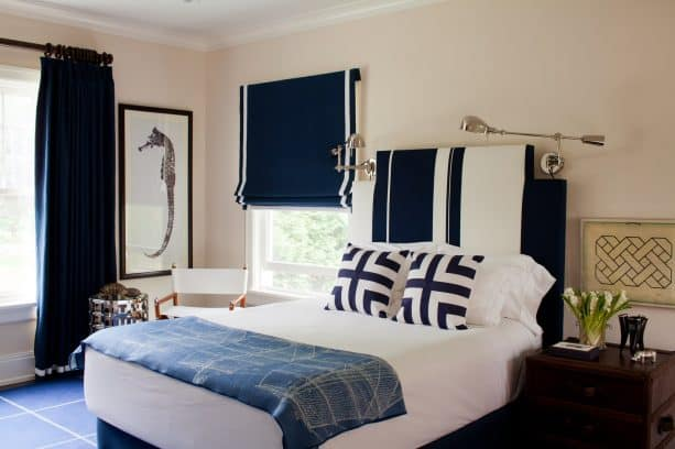 bedroom with navy blue, white, and beige color scheme