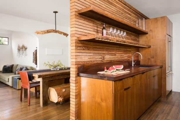 counter to ceiling backsplash from recycled wooden wall framing