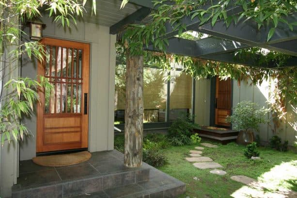 Asian-style entry with three rolled-up bamboo blinds