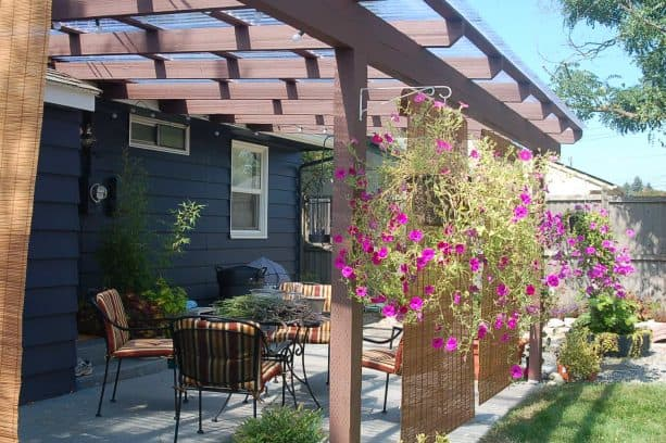 patio roll up bamboo blinds paired with hanging flowery plants