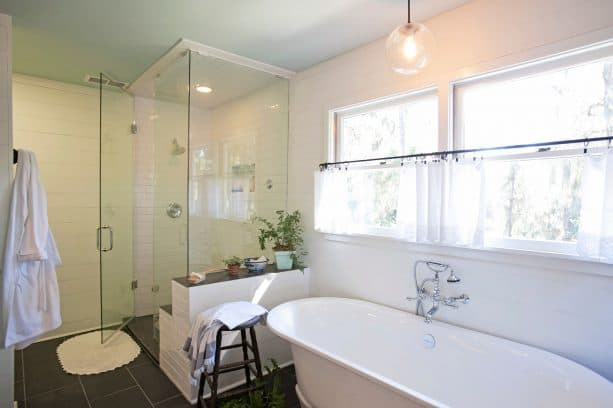 the use of sheer white cafe curtains in a bathroom