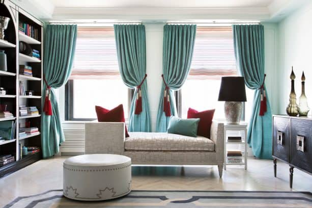 turquoise drapes with red tasseled-tiebacks