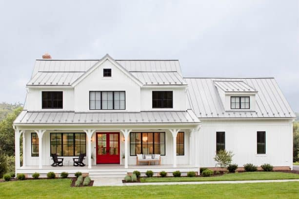 a white farmhouse with metal roof