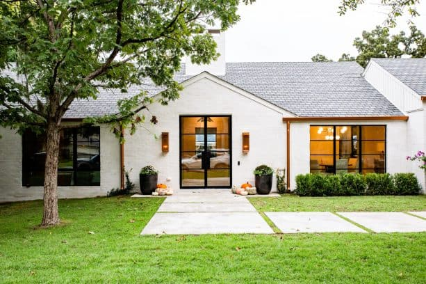 white-painted brick paired with black and copper color in a ranch-style exterior color scheme
