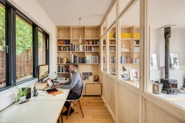 home office with permanent wooden partition that comes with glass window feature