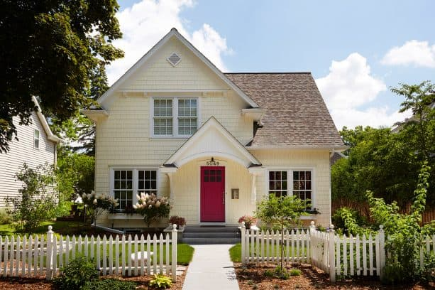 stunning red door in a pale yellow house with white trim design