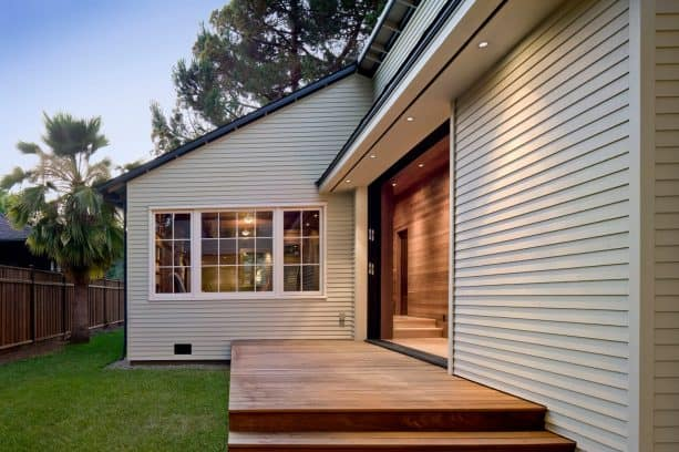 a light, warm grey house with clear-stained deck