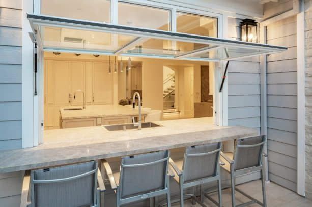 a transom feature to make the pass through window an access for more natural light