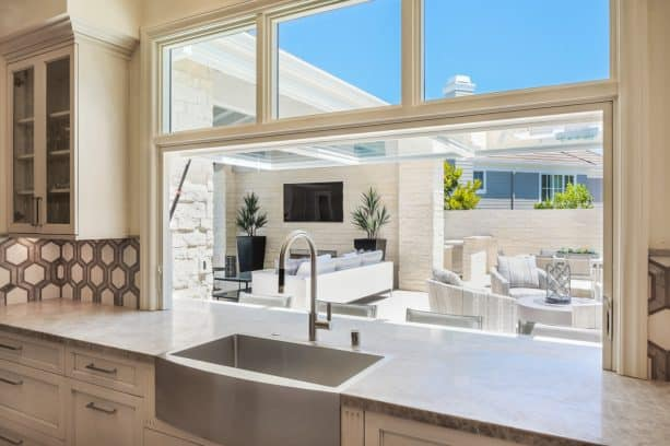 flip-out pass through window gives an easy serving access to the patio area