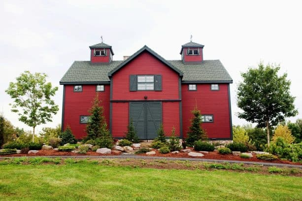 a bold Barn Red farmhouse exterior with black trim and doors