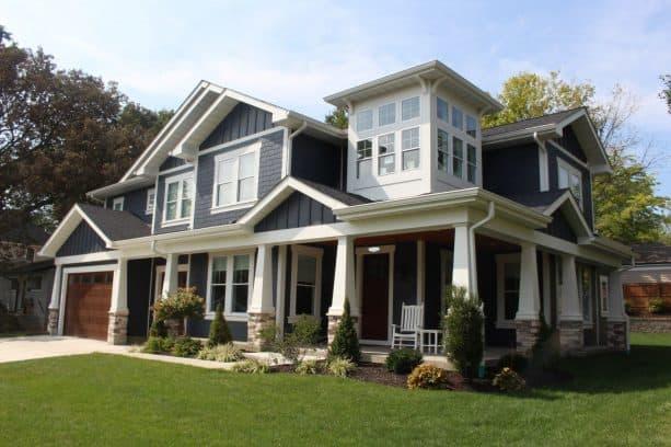 a farmhouse exterior with Deep Ocean James Hardie Siding and white trim
