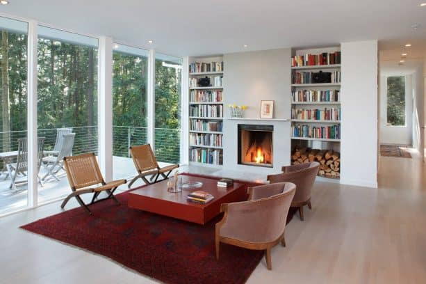 a simple and minimalist fireplace paired with unique built-in bookshelves that comes with stainless-steel box feature for storing wood.jpg