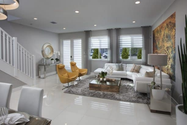contemporary living room with abstract pattern of gold yellow paint and dark gray wall
