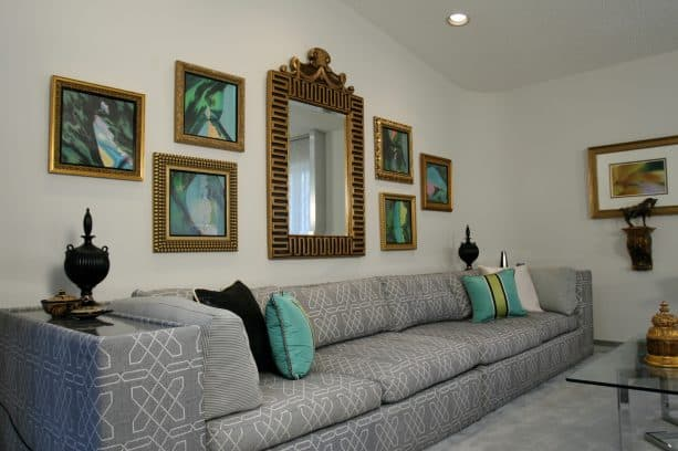 large living room with gold antique mirror frames and gray sizeable sofa