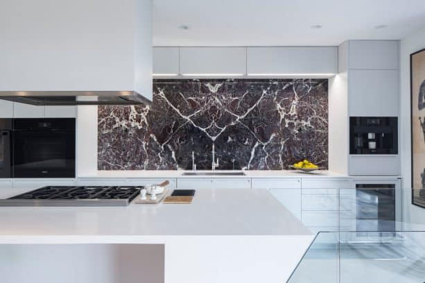 modern kitchen milky white cabinets with attractive black pieces of equipment