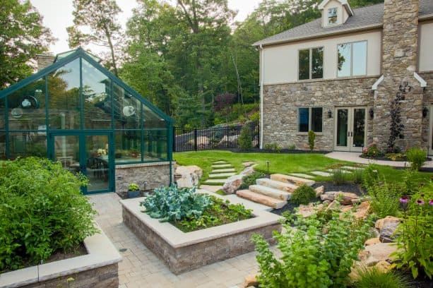 mountainside living with a few stone steps to the raised planters on a slope landscape
