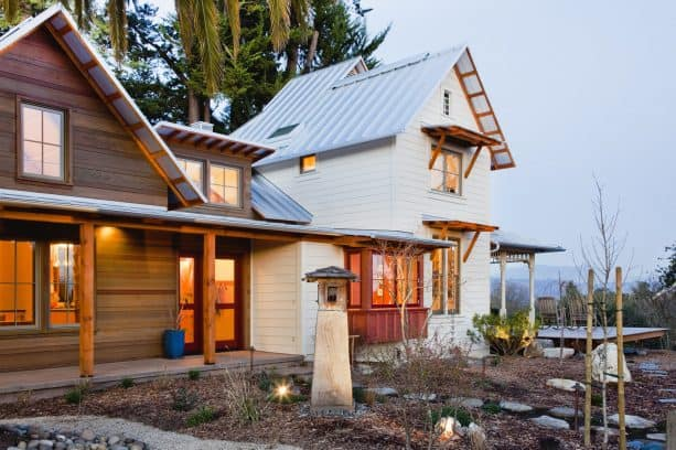 victorian farmhouse with a metal roof and white siding combination