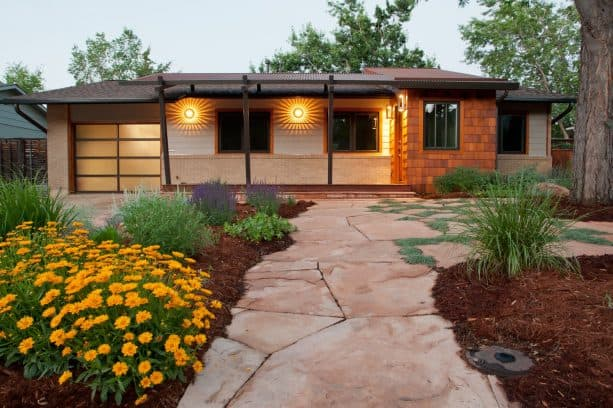 flagstone-made front walkway landscaping idea with ornament of xeric flower beds