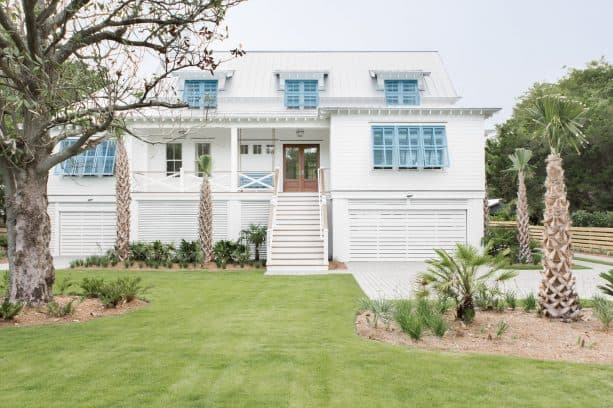 high-profile white house with blue shutters decoration