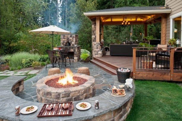 natural flagstone paver patio with seat wall and fire pit