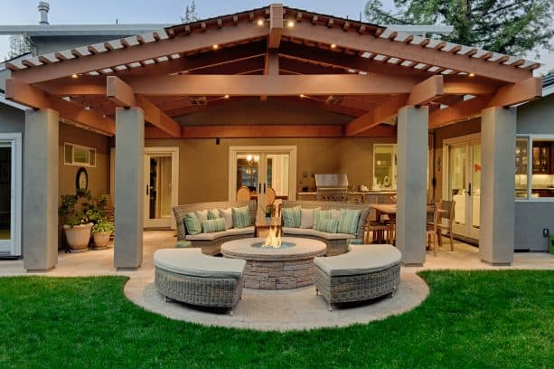 rustic pergola attached to a roof as a covered patio