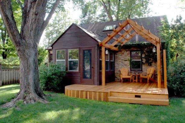 small raised pergola with post and beam structure attached to roof