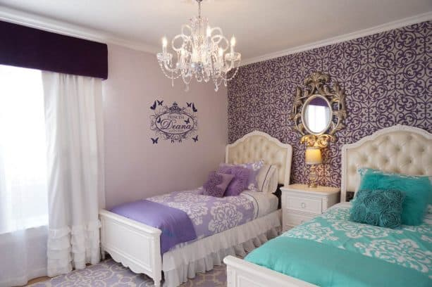 pair a purple bed with a teal bed to create an elegant kids' bedroom