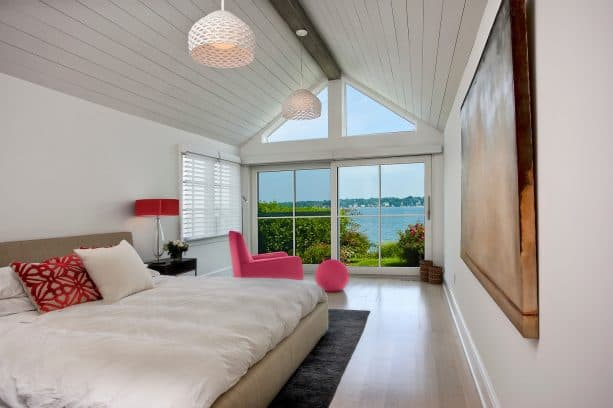 white walls, white bedding, and pink furniture are great for a bright beach style bedroom