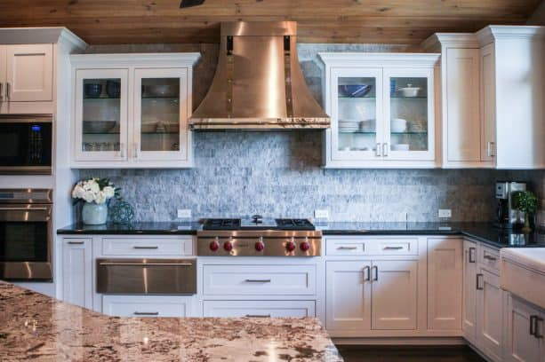 picture of the kitchen and the custom range hood