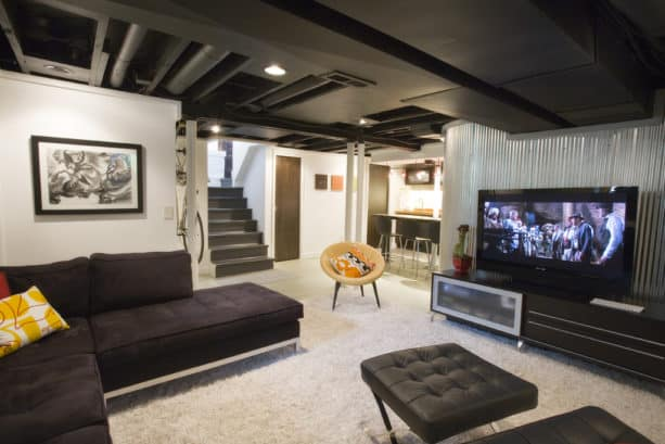 remodeled basement with corrugated metal wall