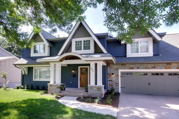 a traditional blue note exterior with white trim